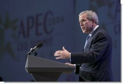 "During an APEC summit, President George W. Bush addresses business executives at the CEO Summit in Santiago, Chile, Nov. 20, 2004. ""I believe we must increase the flow of trade and capital. I know our societies must reward enterprise and open societies and open markets,"" President Bush said. ""I know we've got to reject the blocks and barriers that divide economies and people. And I believe, with the right policies, we can continue to grow."" White House photo by Eric Draper"