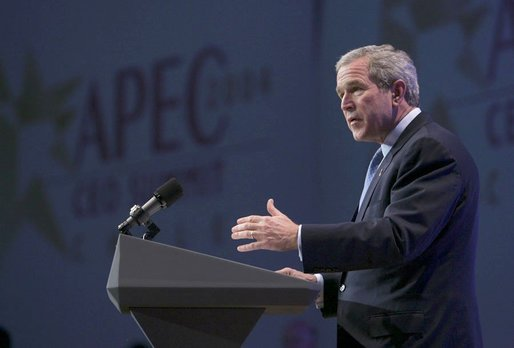 "During an APEC summit, President George W. Bush addresses business executives at the CEO Summit in Santiago, Chile, Nov. 20, 2004. ""I believe we must increase the flow of trade and capital. I know our societies must reward enterprise and open societies and open markets,"" President Bush said. ""I know we've got to reject the blocks and barriers that divide economies and people. And I believe, with the right policies, we can continue to grow.""White House photo by Eric Draper"