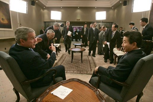 President George W. Bush meets with President Roh Moo-hyun of the Republic of Korea while attending an APEC summit in Santiago, Chile, Nov. 20, 2004.White House photo by Eric Draper