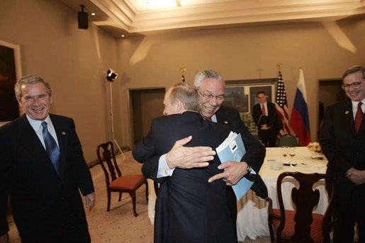 Secretary of State Colin Powell receives a warm reception from Russian President Vladimir Putin during a meeting with President Bush and delegation members including Deputy National Security Advisor Stephen Hadley, far right, in Santiago, Chile, Nov. 20, 2004. White House photo by Eric Draper