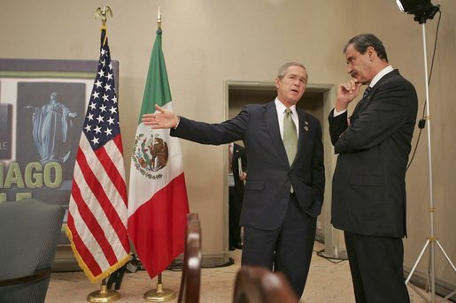 President George W. Bush talks with Mexican President Vicente Fox at the 2004 APEC summit in Santiago, Chile, Nov. 21, 2004. White House photo by Eric Draper