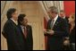 President George W. Bush meets with President Alejandro Toledo of Peru, Manuel Rodriguez Cuadros, Foreign Minister of Peru, far left, and President Toledo's wife, Ms. Elaine Karp, during the APEC Summit at La Moneda Presidential Palace in Santiago, Chile, Sunday, Nov. 21, 2004. White House photo by Eric Draper