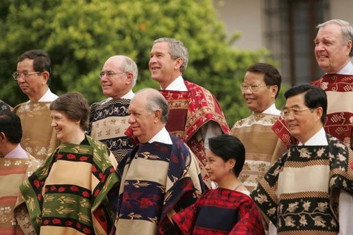 President George W. Bush smiles for a group photo with APEC leaders at La Moneda Presidential Palace in Santiago, Chile, Nov. 21, 2004. White House photo by Paul Morse