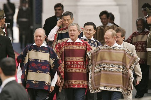 President George W. Bush walks with Chilean President Ricardo Lagos and Russian President Vladimir Putin to an APEC leaders group photo at La Moneda Presidential Palace in Santiago, Chile, Nov. 21, 2004. White House photo by Paul Morse.