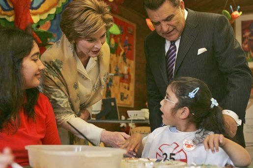 Laura Bush visits children at the Teleton Children's Rehabilitation Center with Chilean television host Mario Kreutzberger, known as Don Francisco, in Santiago, Chile, Nov. 21, 2004. White House photo by Susan Sterner.