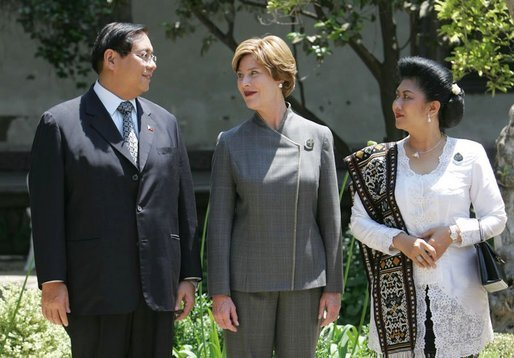 Laura Bush talks with Mr. Jose Miguel T. Arroyo of the Philippines and Mrs. Kristiani Herawati of Indonesia during a program for leaders' spouses in Santiago, Chile, Nov. 20, 2004. White House photo by Susan Sterner.