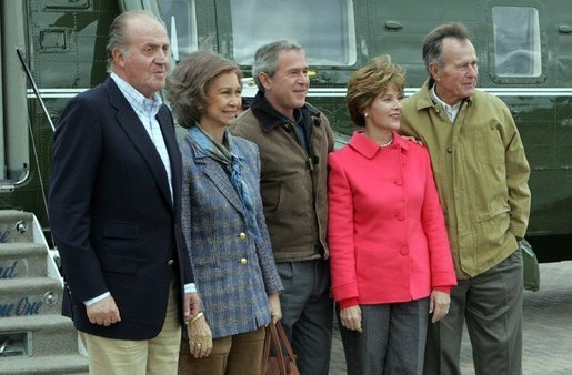 President George W. Bush, Laura Bush, and former President George H.W. Bush welcome Their Majesties King Juan Carlos and Queen Sofia of Spain to the Bush Ranch in Crawford, Texas, Wednesday, Nov. 24, 2004. White House photo by Tina Hager.