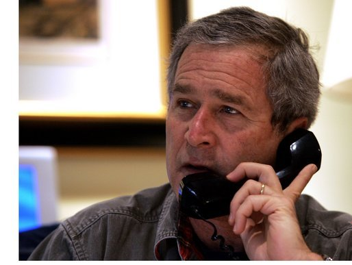 President George W. Bush calls troops Thanksgiving Day from his ranch in Crawford, Texas, Thursday, Nov. 25, 2004. White House photo by Tina Hager.