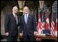 Before a bilateral session at Parliament Hill, President George W. Bush and Canadian Prime Minister Paul Martin meet in the rotunda in Ottawa, Canada, Nov. 30, 2004. White House photo by Paul Morse