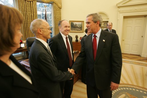 President George W. Bush greets Dr. Finn Kydland during a ceremony honoring the 2004 Nobel Laureates in the Oval Office Wednesday, Dec. 1, 2004. Dr. Kydland received the Nobel Prize in Economics for his analyzation of the driving forces behind business cycles has influenced the practice of economic and monetary policy.White House photo by Tina Hager