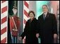 President George W. Bush and Laura Bush arrive at the Pageant of Peace to light the National Christmas Tree on the Ellipse near the White House Dec. 2, 2004. White House photo by Paul Morse.
