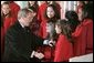 President George W. Bush greets members of the West Tennessee Youth Chorus during the National Christmas Tree lighting ceremony on the Ellipse in front of the White House Dec. 2, 2004. White House photo by Paul Morse.