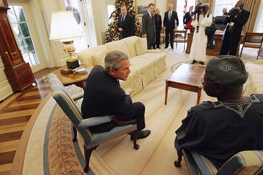President George W. Bush talks with Nigerian President Olusegun Obasanjo in the Oval Office Thursday, Dec. 02, 2004. White House photo by Tina Hager.
