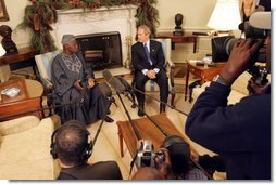 "President George W. Bush meets with Nigerian President Olusegun Obasanjo in the Oval Office Thursday, Dec. 02, 2004. ""I think it is vital that the continent of Africa be a place of freedom and democracy and prosperity and hope, where people can grow up and realize their dreams,"" President Bush said after the meeting. ""It's a continent that has got vast potential, and the United States wants to help the people of Africa realize that potential.""  White House photo by Tina Hager"