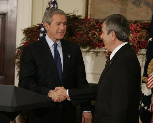 President George W. Bush greets Nebraska Governor Mike Johanns after nominating him for Secretary of Agriculture in the Roosevelt Room of the White House, Dec. 2, 2004. White House photo by Paul Morse.