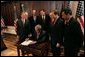 President George W. Bush signs S. 150, The Internet Tax Nondiscrimination Act, in the Eisenhower Executive Office Building Friday, Dec. 3, 2004. Watching the signing are, from left: Congressman Chris Cox, R-Calif.; John Snow, Secretary of the Treasury; Senator Ron Wyden, D-Ore.; Senator George Allen, R-Va.; Don Evans, Secretary of Commerce; Senator John Sununu, R-N.H.; Congressman Mel Watt, D-N.C. White House photo by Tina Hager