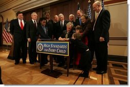 President George W. Bush signs H.R. 1350, the Individuals with Disabilities Education Improvement Act of 2004, in the Dwight D. Eisenhower Executive Office Building in Washington, D.C., Friday, Dec. 3, 2004.  White House photo by Tina Hager