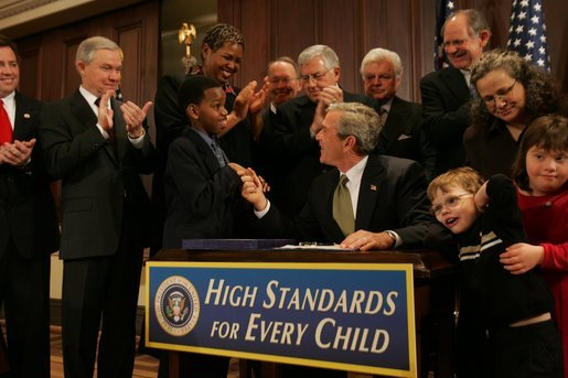 President George W. Bush greets Kyle Stevenson during signing ceremony for the Individuals with Disabilities Education Improvement Act of 2004 in the Dwight D. Eisenhower Executive Office Building in Washington, D.C., Friday, Dec. 3, 2004. The bill is intended to enhance learning by promoting accountability, parental involvement, and improved training for special education teachers. White House photo by Tina Hager