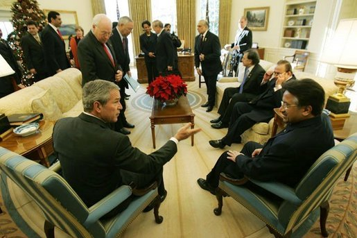President George W. Bush meets with President Pervez Musharraf of Pakistan Saturday, Dec. 4, 2004 in the Oval Office.White House photo by Tina Hager
