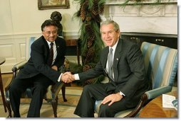 President George W. Bush and Pakistan President Pervez Musharraf pose during a photo-op in the Oval Office Saturday, Dec. 4, 2004. White House photo by Tina Hager