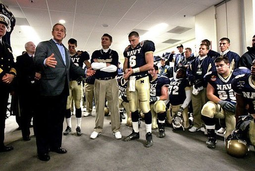President George W. Bush addresses midshipmen in the Navy locker room before the 105th annual Army/Navy game in Philadelphia, Pa., Dec. 4, 2004. White House photo by Tina Hager
