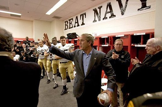 President George W. Bush gives a final wave to USMA cadets before the start of the Army/Navy game in Philadelphia, Pa., Dec. 4, 2004. White House photo by Tina Hager