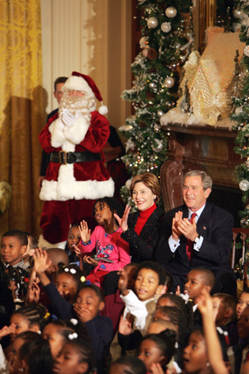 President George W. Bush Laura Bush watch a puppet show and sing Christmas Carols with dozens of school children attending the White House Children's Christmas Program in the East Room, Monday, Dec. 6, 2004. White House photo by Susan Sterner