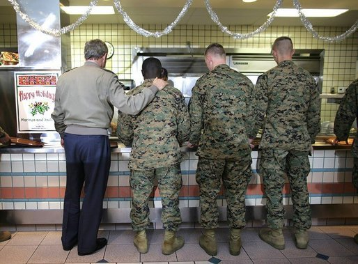 President George W. Bush stands in a chow line with Marines before sitting down for lunch with military personnel at Marine Corps Base Camp Pendleton, Calif., Tuesday, Dec. 7, 2004.White House photo by Eric Draper