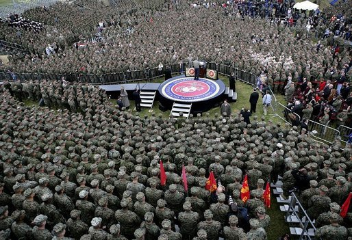 President George W. Bush delivers remarks to nearly 7,000 military personnel and families at Marine Corps Base Camp Pendleton, Calif., Tuesday, Dec. 7, 2004.White House photo by Eric Draper