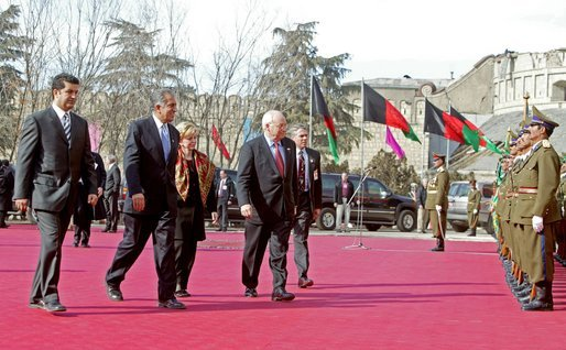 Prior to the inauguration of Afghanistan President Hamid Karzai, Vice President Dick Cheney and his wife, Lynne, and U.S. Ambassador to Afghanistan Zalmay Khalilzad, second on left, attend a welcoming ceremony at the Presidential Palace in Kabul, Afghanistan, Dec. 7, 2004. White House photo by David Bohrer