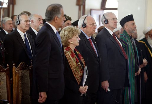Vice President Dick Cheney and his wife, Lynne, attend the swearing-in ceremony for Afghanistan President Hamid Karzai at Salaam Khana in Kabul, Afghanistan, Dec. 7, 2004. President Karzai is Afghanistan's first democratically-elected president in Afghanistan's history. Also pictured, from left back, Secretary of Defense Donald Rumsfeld, Afghanistan Vice President Hedayat Amin Arsala, left front; U.S. Ambassador to Afghanistan Zalmay Khalilzad, and Afghanistan President Hamid Karzai, right. White House photo by David Bohrer