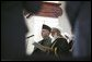 President of Afghanistan Hamid Karzai is sworn in by Afghanistan Supreme Court Chief Justice Fazil Hadi Shinwari during President Karzai's inauguration ceremony at Salaam Khana in Kabul, Afghanistan, Dec. 7, 2004. White House photo by David Bohrer