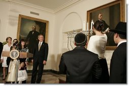 "President George W. Bush and Laura Bush watch the lighting of the Menorah at the White House Thursday, Dec. 9, 2004. ""We are honored to celebrate the miracle of Hanukkah in the White House this evening,"" said the President.  White House photo by Paul Morse"