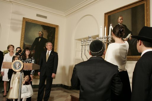 "President George W. Bush and Laura Bush watch the lighting of the Menorah at the White House Thursday, Dec. 9, 2004. ""We are honored to celebrate the miracle of Hanukkah in the White House this evening,"" said the President. White House photo by Paul Morse."