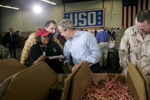 "President George W. Bush and Laura Bush visit Operation USO CarePackage at Fort Belvior, Va., Friday, Dec. 10, 2004. ""This is one way of saying, America appreciates your service to freedom and peace and our security,"" said the President in his remarks about the program that has delivered more than 480,000 care packages.White House photo by Paul Morse"