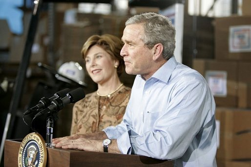 "President George W. Bush and Laura Bush visit Operation USO CarePackage at Fort Belvior, Va., Friday, Dec. 10, 2004. ""This is one way of saying, America appreciates your service to freedom and peace and our security,"" said the President in his remarks about the program that has delivered more than 480,000 care packages. White House photo by Paul Morse"