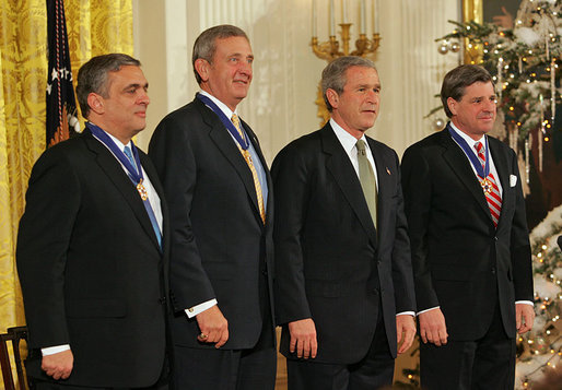 President George W. Bush stands with recipients of the Presidential Medal of Freedom during a ceremony in the East Room Tuesday, Dec. 14, 2004. From left, they are CIA Director George Tenet, Ambassador L. Paul Bremer III and U.S. Army General Tommy R. Franks. White House photo by Tina Hager