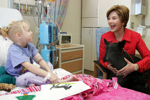 Laura Bush and her Scottish Terrier, Barney, visit with Carly Batchelder,8, a patient at Children's National Medical Center in Washington, D.C., Wednesday, Dec. 15, 2004. White House photo by Susan Sterner