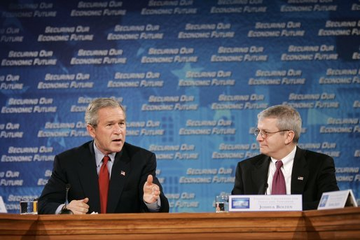 "President George W. Bush and Joshua Bolten, director of the Office of Management and Budget, talk during a White House economic conference at the Ronald Reagan Building and International Trade Center in Washington, D.C., Thursday, Dec. 16, 2004. Mr. Bolten was the moderator for the session titled ""Financial Challenges for Today and Tomorrow."" White House photo by Paul Morse"