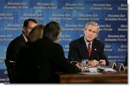 President George W. Bush listens as Liz Ann Sonders, chief investment strategist at the Charles Schwab & Co., speaks during a White House economic conference at the Ronald Reagan Building and International Trade Center in Washington, D.C., Thursday, Dec. 16, 2004. Also pictured are William Roper, dean at the School of Medicine at the University of North Carolina, Chapel Hill, right, and James Glassman, Senior economist at JP Morgan Chase, left.  White House photo by Paul Morse