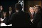 President George W. Bush listens to Time Warner CEO Richard Parsons, center, during a White House economic conference at the Ronald Reagan Building and International Trade Center in Washington, D.C., Thursday, Dec. 16, 2004. Also pictured are, James Glassman, Senior economist at JP Morgan Chase, far left, and former Rep. Tim Penny, D-Minn, right. White House photo by Paul Morse