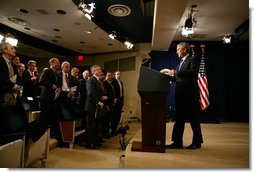 President George W. Bush arrives at a press conference in room 450 of the Eisenhower Executive Office Building on December 20, 2004.  White House photo by Paul Morse