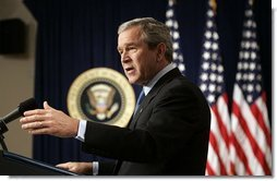 President George W. Bush answers questions during a press conference in room 450 of the Eisenhower Executive Office Building on December 20, 2004.  White House photo by Paul Morse