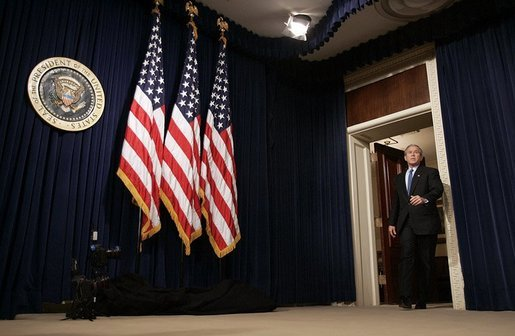 President George W. Bush arrives at a press conference in room 450 of the Eisenhower Executive Office Building on December 20, 2004. White House photo by Paul Morse.