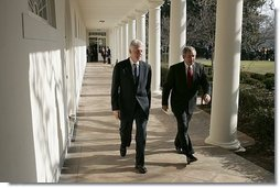 President George W. Bush walks with former President Bill Clinton along the colonnade at the White House Monday, Jan. 3, 2005. Former Presidents Clinton and George H.W. Bush are leading a nationwide charitable fundraising to aid victims of last week's earthquake and tsunamis in South Asia.  White House photo by Susan Sterner
