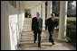 President George W. Bush walks with former President Bill Clinton along the colonnade at the White House Monday, Jan. 3, 2005. Former Presidents Clinton and George H.W. Bush are leading a nationwide charitable fundraising to aid victims of last week's earthquake and tsunamis in South Asia. White House photo by Susan Sterner.