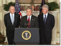 President George W. Bush announces a nationwide charitable fundraising effort to be led by former President George H.W. Bush, left, and former President Bill Clinton to aid victims of last week's earthquake and tsunamis in South Asia in the Roosevelt Room, Monday, January 3, 2005.   White House photo by Tina Hager