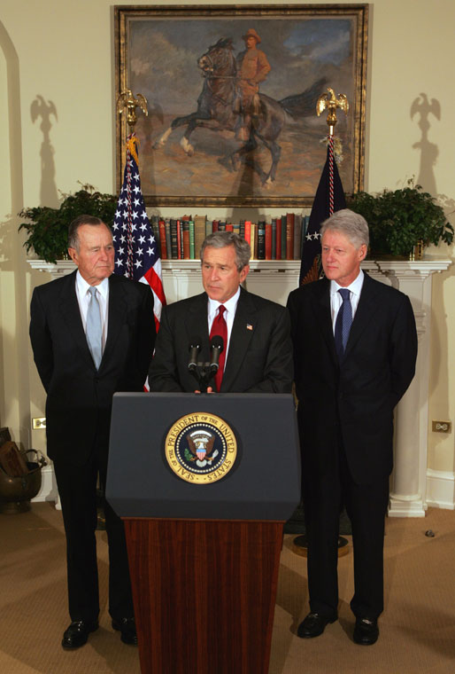 President George W. Bush announces a nationwide charitable fundraising effort to be led by former President George H.W. Bush, left, and former President Bill Clinton to aid victims of last week's earthquake and tsunamis in South Asia in the Roosevelt Room, Monday, January 3, 2005. White House photo by Tina Hager.