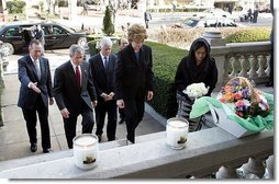 Laura Bush approaches a candle-lit memorial honoring the victims of the recent tsunami at the Embassy of Indonesia during a visit with President George W. Bush and former Presidents Bush and Clinton in Washington, D.C., Monday, Jan. 3, 2005.  White House photo by Susan Sterner