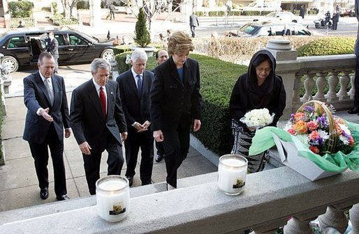 Laura Bush approaches a candle-lit memorial honoring the victims of the recent tsunami at the Embassy of Indonesia during a visit with President George W. Bush and former Presidents Bush and Clinton in Washington, D.C., Monday, Jan. 3, 2005. White House photo by Susan Sterner.